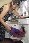pregnant woman emptying washing machine.jpg